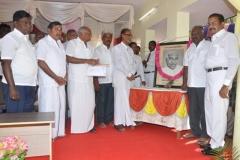 chief-guest-mr-pazha-nedumaran-garlanding-the-kamarajar-photo-112th-kamarajar-birthday-competition-prize-distrubution-function-on-25-07-2014